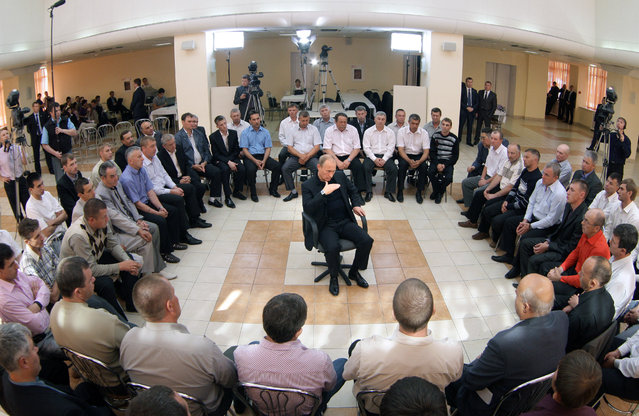 Russia's Prime Minister Vladimir Putin, center, gestures speaking at his meeting with miners in the western Siberian city of Novokuznetsk, Russia, Thursday, June 24, 2010. (Photo by Alexei Druzhinin/AP Photo/RIA-Novosti)