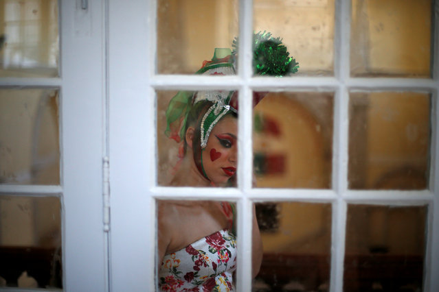 A member of Alfama's group is seen before going to the Saint Anthony's Parade in Lisbon, Portugal June 12, 2016. (Photo by Rafael Marchante/Reuters)
