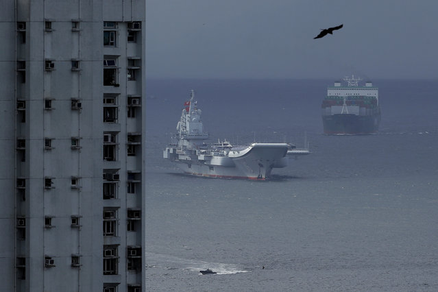 The Liaoning, China's first domestically built aircraft carrier, sails into Hong Kong for port call, Friday, July 7, 2017, to celebrate the 20th anniversary of the People's Liberation Army (PLA) garrison's presence in the semi-autonomous Chinese city and former British colony. (Photo by Kin Cheung/AP Photo)