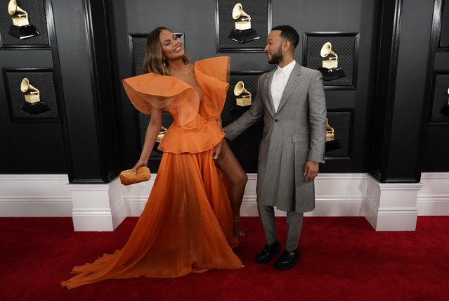 Chrissy Teigen and John Legend attends the 62nd Annual GRAMMY Awards at Staples Center on January 26, 2020 in Los Angeles, California. (Photo by Mike Blake/Reuters)