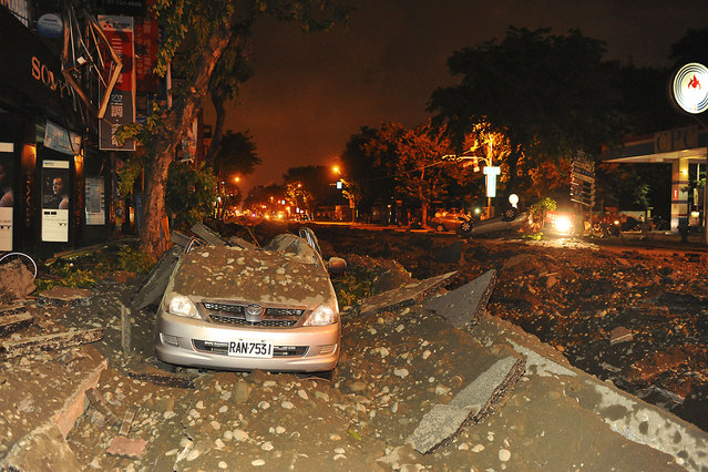Wreckage of a damaged car is pictured after an explosion in Kaohsiung, southern Taiwan, August 1, 2014. An explosion caused by a gas leak in the southern Taiwanese city Kaohsiung has killed 15 people and injured another 243, Taiwanese media reported on Friday. (Photo by Reuters/Stringer)