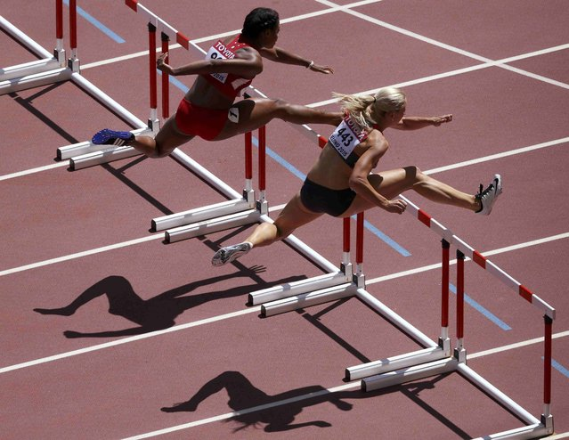 Cindy Roleder of Germany (R) and Sharika Nelvis of the U.S. compete in the women's 100 metres hurdles heats during the 15th IAAF World Championships at the National Stadium in Beijing, China August 27, 2015. (Photo by Dylan Martinez/Reuters)