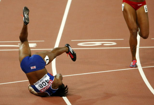 Tiffany Porter of Britain falls after competing in the women's 100 metres hurdles final during the 15th IAAF World Championships at the National Stadium in Beijing, China August 28, 2015. (Photo by David Gray/Reuters)