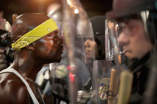 Demonstrators confront police while protesting the acquittal of former St. Louis police officer Jason Stockley on September 16, 2017 in St. Louis, Missouri. Dozens of business windows were smashed and at least two police cars were damaged during a second day of protests following the acquittal of Stockley, who was been charged with first-degree murder last year following the 2011 on-duty shooting of Anthony Lamar Smith. (Photo by Scott Olson/Getty Images)