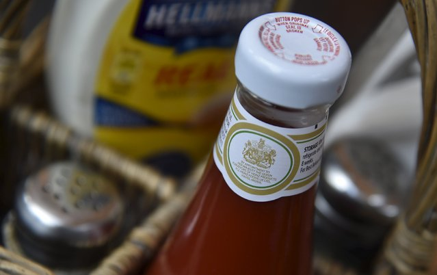 A royal warrant is seen printed on a bottle of tomato sauce, manufactured by food company Heinz, at a cafe in central London, Britain, August 21, 2015. (Photo by Toby Melville/Reuters)