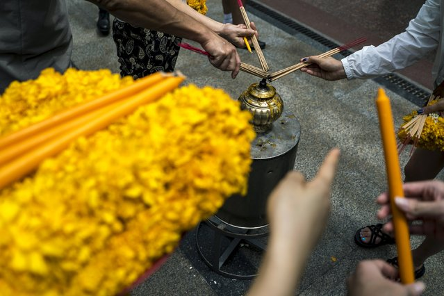 People light incense while praying at the Erawan shrine, the site of recent deadly blast, in central Bangkok, Thailand, September 3, 2015. (Photo by Athit Perawongmetha/Reuters)