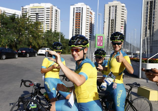 Members of Australia's cycling team take happy snaps outside the Olympic Village in Rio de Janeiro, Brazil on August 2, 2016. (Photo by Jeremy Lee/Reuters)