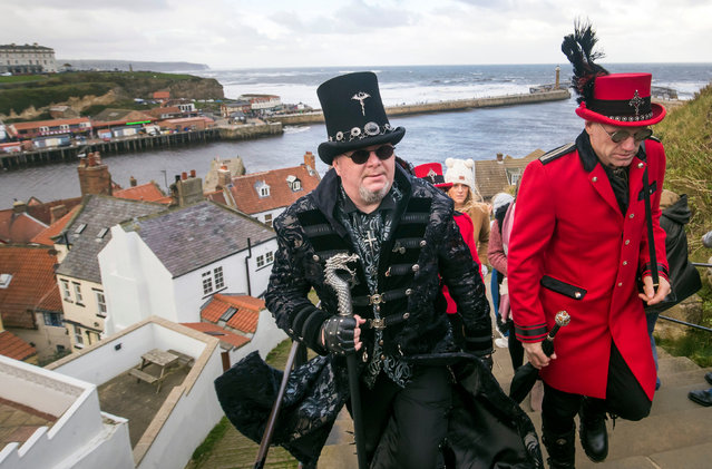 """People attend the Whitby Goth Weekend in Whitby, Yorkshire, where Bram Stoker found some of his inspiration for """"Dracula"""" after staying in the town in 1890 in Whitby, United Kingdom on October 29, 2017. (Photo by Danny Lawson/PA Images via Getty Images)"""