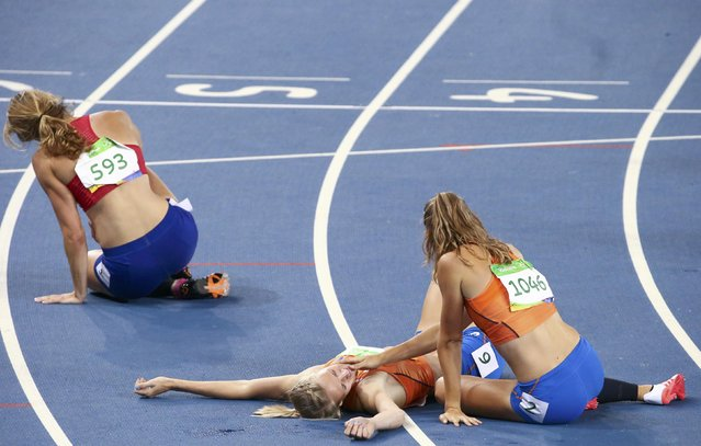 2016 Rio Olympics, Athletics, Final, Women's Heptathlon 800m, Olympic Stadium, Rio de Janeiro, Brazil on August 13, 2016. Nadine Visser (NED) of Netherlands and Anouk Vetter (NED) of Netherlands react. (Photo by David Gray/Reuters)
