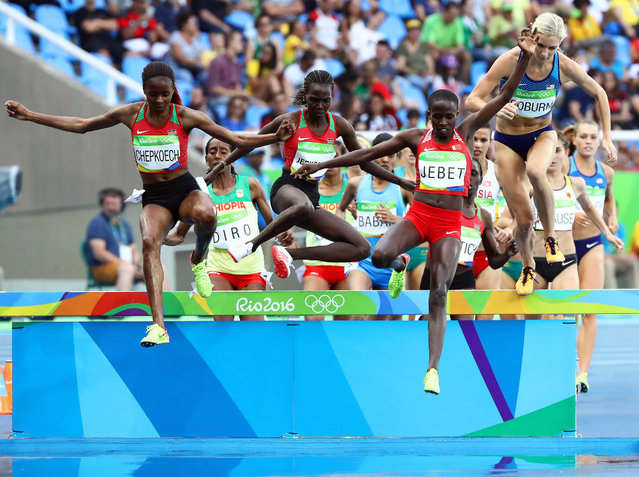 (L-R) Beatrice Chepkoech of Kenya, Hyvin Kiyeng Jepkemoi of Kenya, Ruth Jebet of Bahrain, and Emma Coburn of the USA compete during the women's 3000m Steeplechase final of the Rio 2016 Olympic Games Athletics, Track and Field events at the Olympic Stadium in Rio de Janeiro, Brazil, 15 August 2016. Jebet won the gold medal ahead of second placed Jepkemoi and third placed Coburn. (Photo by Diego Azubel/EPA)