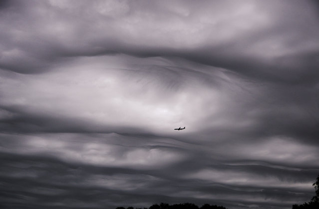 "August. Asperitas clouds over Adelaide, South Australia. (Photo by Asbjorn ""Aussie"" Kanck/Australian Bureau of Meteorology)"