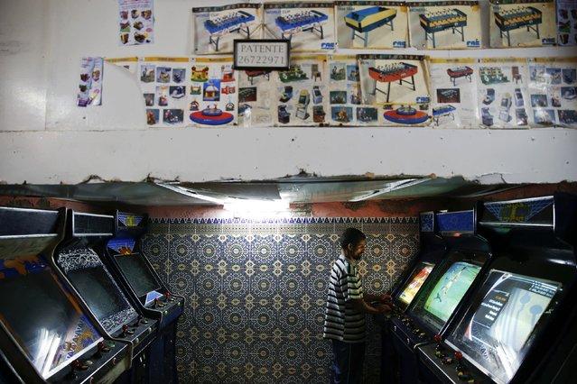 A man plays video games in an entertainment saloon in Rabat's Medina September 21, 2014. (Photo by Damir Sagolj/Reuters)