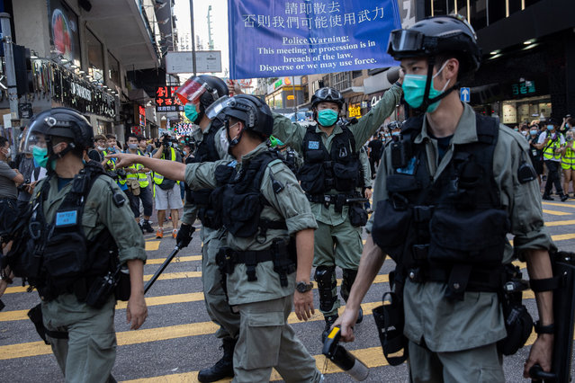 Police clear a street during a silent march against the national security law in Hong Kong, China, 28 June 2020. China's top legislative body is set to pass a legislation for Hong Kong aiming to prevent, stop and punish acts of secession, subversion, terrorism and collusion with foreign forces to endanger national security. (Photo by Jerome Favre/EPA/EFE)