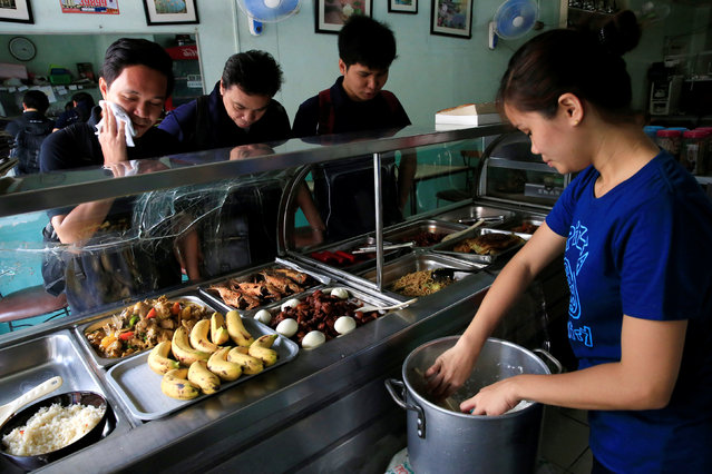 Customers are checking food items at a small restaurant in Metro Manila, Philippines, August 4, 2016. (Photo by Romeo Ranoco/Reuters)