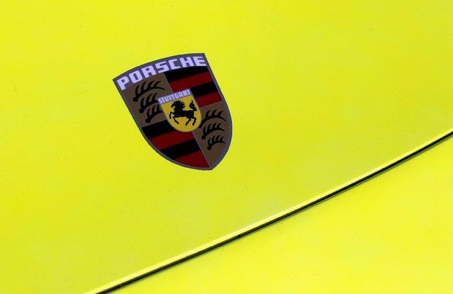 The Porsche logo is seen on the hood of a sports car during the Porsche Rennsport Reunion V at Laguna Seca Raceway near Salinas, California, September 26, 2015. (Photo by Michael Fiala/Reuters)