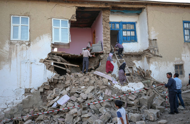 Citizens try collect their belongings from their damaged houses at Elacmaz neighborhood after 5.4 magnitude earthquake hit Gurpinar district of Van, Turkey on June 25, 2020. (Photo by Ozkan Bilgin/Anadolu Agency via Getty Images)
