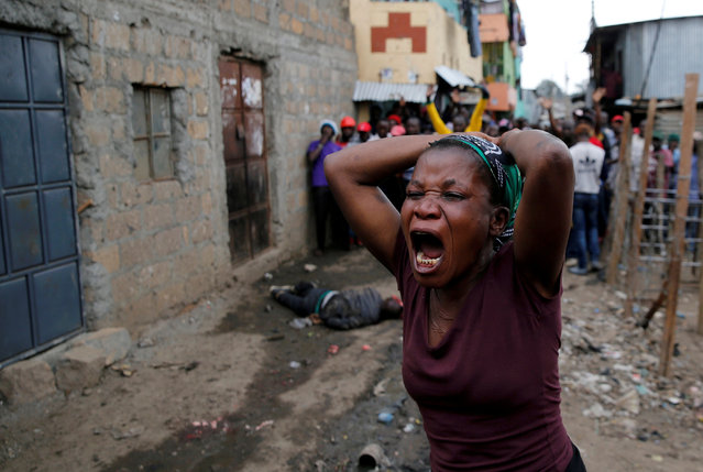 A woman gestures as she mourns the death of a protester in Mathare, in Nairobi, Kenya, August 9, 2017. (Photo by Thomas Mukoya/Reuters)