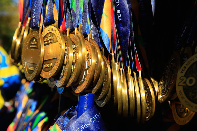 Medals are seen beyond the finish line in Central Park during the 2014 TCS New York City Marathon on November 2, 2014 in New York City. (Photo by Alex Trautwig/Getty Images)