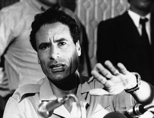 Libyan Leader Colonel Moammar al-Gadhafi addresses newsman at a press conference at the Palais des Nations conference hall in Aligiers, September 7, 1973. Col. Gadhafi is currently in Algiers where he attends the fourth summit meeting of non-aligned countries. (Photo by AP Photo)