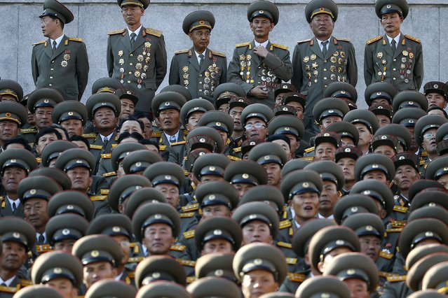Senior North Korean military officers wait for the start of the parade celebrating the 70th anniversary of the founding of the ruling Workers' Party of Korea, in Pyongyang October 10, 2015. (Photo by Damir Sagolj/Reuters)