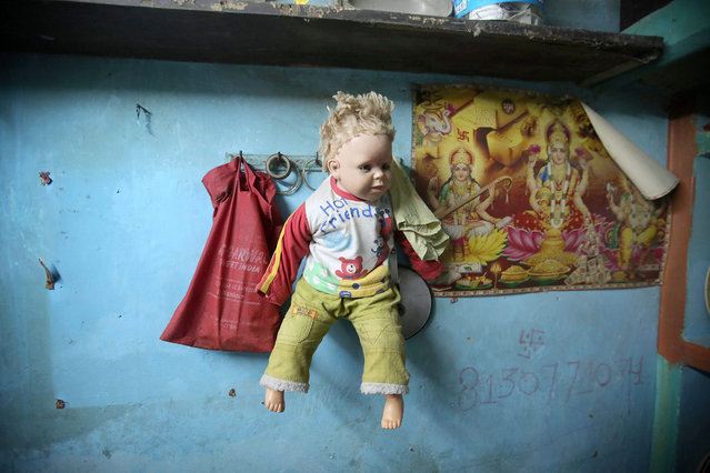 A doll hangs on a wall at the home of a four-year-old rape victim in a slum area, New Delhi, India, 14 October 2015. According to media reports, two men are being questioned by police related to the rape of a 4-year-old girl in Delhi. The girl was found by some railway lines on 09 October and is in hospital with serious injuries. (Photo by Rajat Gupta/EPA)