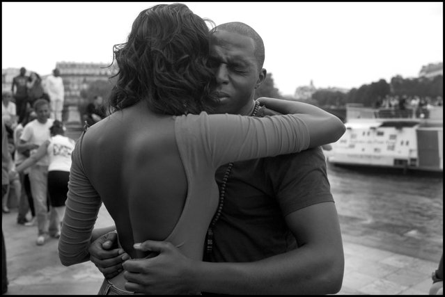 A moment so wonderful it almost hurts-dancing along the Seine in Paris. (Photo and comment by Peter Turnley)