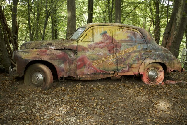 Michael's painted and designed Holden car that has rotted for years in Neandertal Germany, September 11, 2016. (Photo by Christoph Hagen/Barcroft Images)