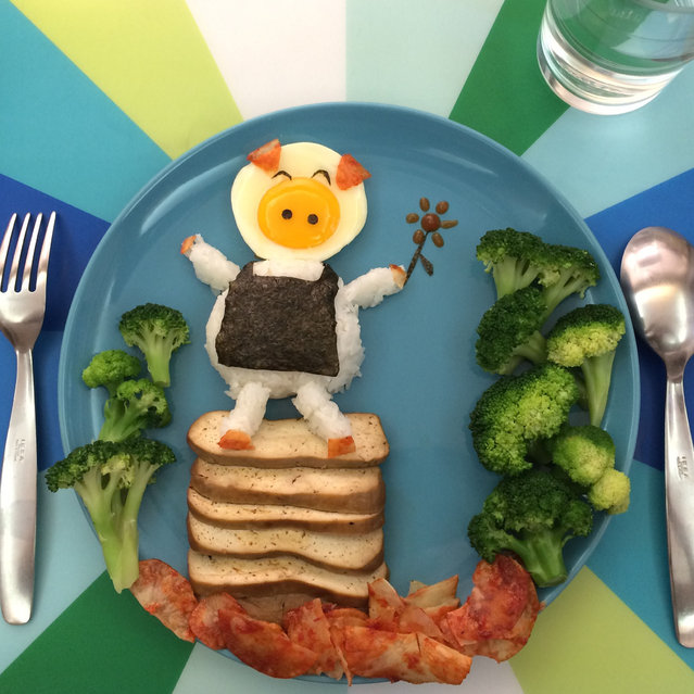 Annes egg art a smiling pig standing on a tower of toast with a sushi roll apron. (Photo by Anne Widya/Caters News)