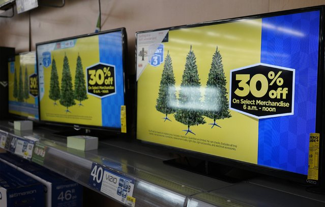 The special Black Friday prices are shown on TVs for sale at Walmart on Black Friday in Broomfield, Colorado November 28, 2014. (Photo by Rick Wilking/Reuters)