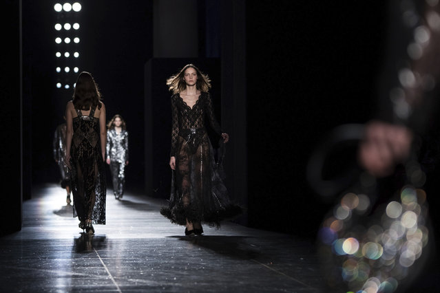 Models wear creations by designer Christopher Kane at the Autumn/Winter 2018 fashion week runway show in London, Monday, February 19, 2018.(Photo by Vianney Le Caer/Invision/AP Photo)