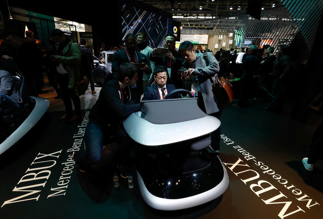 A visitor tries the MBUX (Mercedes-Benz User Experience) multimedia system during the Mobile World Congress in Barcelona, Spain, February 27, 2018. (Photo by Yves Herman/Reuters)