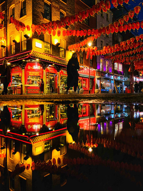 Chinese New Year, London. Urban Life youth winner. The vibrant Chinese lanterns and colours in Chinatown, London celebrating Chinese new year captured in a puddle. (Photo by Olivia Ritchie/UK Landscape Photographer of the Year 2020)