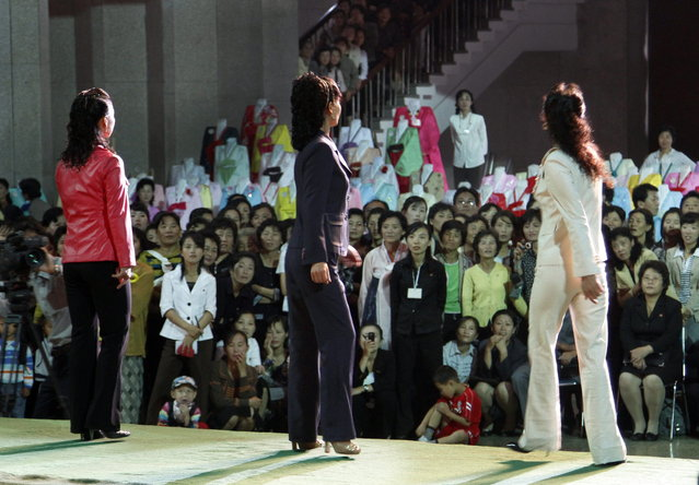 In this September 19, 2012 photo, North Korean women perform during a fashion show at the 10th national Korean dress exhibition at Central Youth Hall in Pyongyang, North Korea. (Photo by Jon Chol Jin/AP Photo)