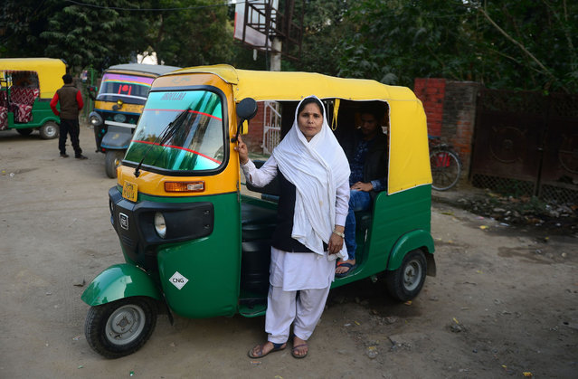 Tabasumm, 30, an auto-rickshaw driver, poses with her vehicle in Allahabad, India on February 22, 2018. (Photo by Sanjay Kanojia/AFP Photo)