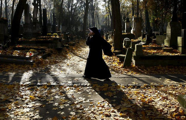 A nun walks through the Powazki cemetery during All Saints Day in Warsaw, Poland November 1, 2015. Poles mark All Saints Day by visiting the graves of loved ones. (Photo by Kacper Pempel/Reuters)