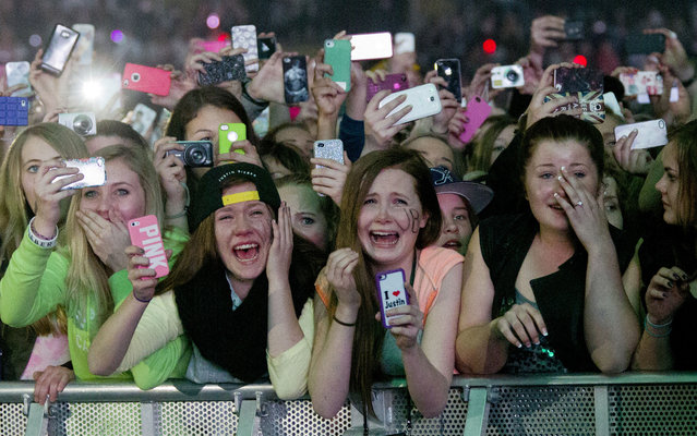 """Young fans of Canadian singer Justin Bieber attend his concert as part of the """"Believe Tour"""" at Telenor Arena in Fornebu, Norway on April 16, 2013. (Photo by Daniel Sannum Lauten/AFP Photo)"""