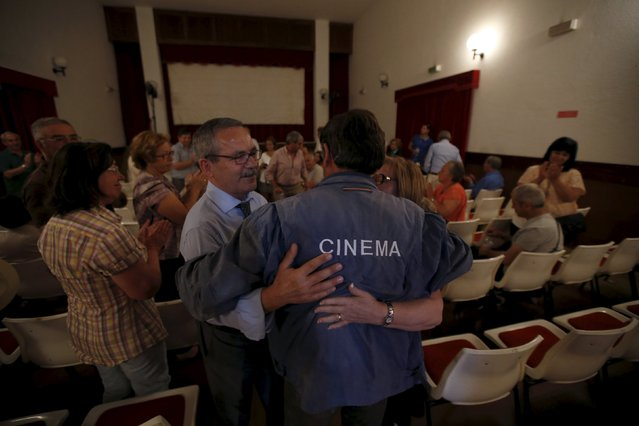 Projectionist Antonio Feliciano, 75, is congratulated by a crowd at the end of a projection in Monforte, Portugal May 16, 2015. (Photo by Rafael Marchante/Reuters)