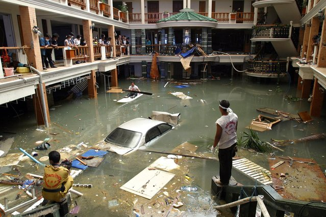 In this December 28, 2004 file photo, rescue and clean-up crew survey a flooded lobby at the Seapearl Beach Hotel along Patong Beach on Phuket Island, Thailand, after massive tsunami waves smashed coastlines Sunday morning. (Photo by Deddeda Stemler/AP Photo/CP)