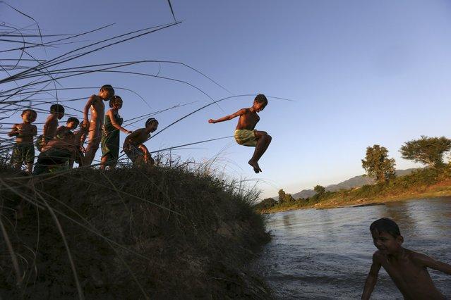 Children play in a creek in Naypyitaw, Myanmar, November 14, 2015. (Photo by Soe Zeya Tun/Reuters)