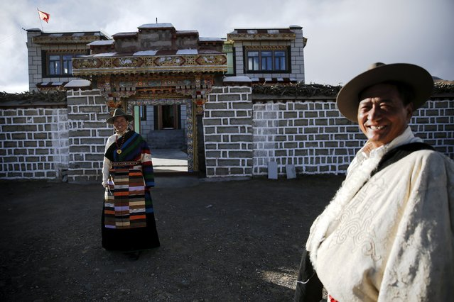 Tibetan herdsman Lob Sang (R) and his wife Lomo smile in front of their home after being visited by foreign reporters on a government organised tour in Damxung county of the Tibet Autonomous Region, China November 18, 2015. (Photo by Damir Sagolj/Reuters)