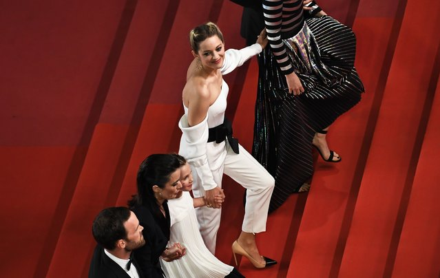 "(From L) French actor Alban Lenoir, French director Vanessa Filho, French actress Ayline Aksoy- Etaix, and French actress Marion Cotillard arrive on May 12, 2018 for the screening of the film ""Gueule d' Ange (Angel Face)"" at the 71 st edition of the Cannes Film Festival in Cannes, southern France. (Photo by Anne-Christine Poujoulat/AFP Photo)"