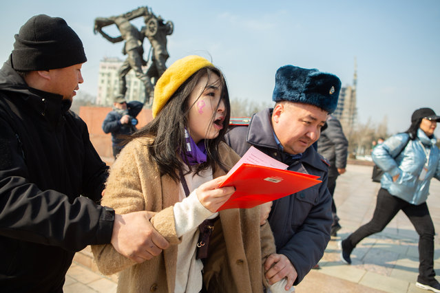 Kyrgyz law enforcement officers detain a women's rights activist during a rally on International Women's Day in Bishkek, Kyrgyzstan on March 8, 2020. (Photo by Gulzhan Turdubaeva/Radio Free Europe/Radio Liberty)
