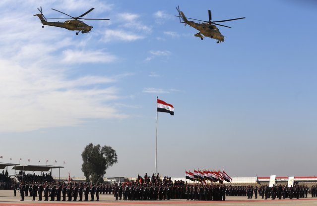 Iraqi soldiers take part in their graduation ceremony during the Iraqi Army Day's anniversary celebration in Baghdad January 6, 2015. (Photo by Thaier al-Sudani/Reuters)