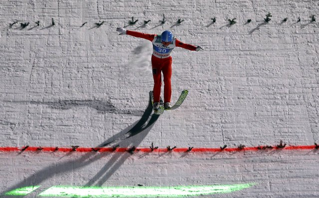 Dimitry Vassiliev from Russia lands during the final jumping of the four-hills ski jumping tournament in Bischofshofen, January 6, 2015. (Photo by Dominic Ebenbichler/Reuters)