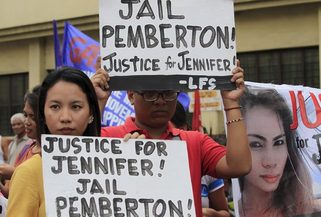 Protesters display placards outside a court in Olongapo city, north of Manila December 1, 2015. A Philippine court found a U.S. Marine guilty of killing a transgender woman on Tuesday, jailing him for six to 12 years in a case that has reignited debate over the American military presence in its former colony. (Photo by Romeo Ranoco/Reuters)