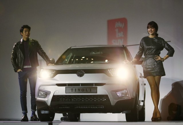 Models pose with Ssangyong Motor Co's Tivoli during its launch ceremony in Seoul January 13, 2015. Ssangyong Motor unveiled the Tivoli in South Korea on Tuesday, its first new model launch in four years, hoping to accelerate its turnaround from the brink of bankruptcy in the wake of the global financial crisis. (Photo by Kim Hong-Ji/Reuters)