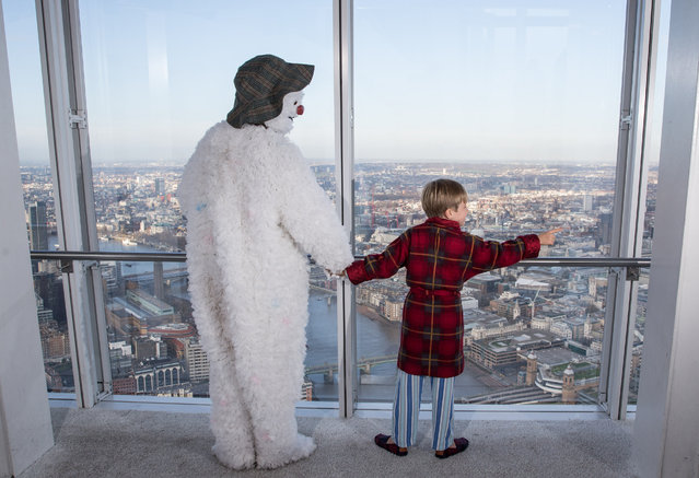 The Snowman and Boy from the Peacock Theatre production of The Snowman attend a photo-call at the Shard in London, England on December 2, 2015. (Photo by James Gourley/Shutterstock)