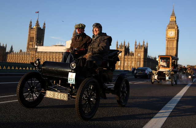Participants drive their vintage cars past Westminster Bridge during the annual London to Brighton veteran car run in London, Britain November 6, 2016. (Photo by Neil Hall/Reuters)