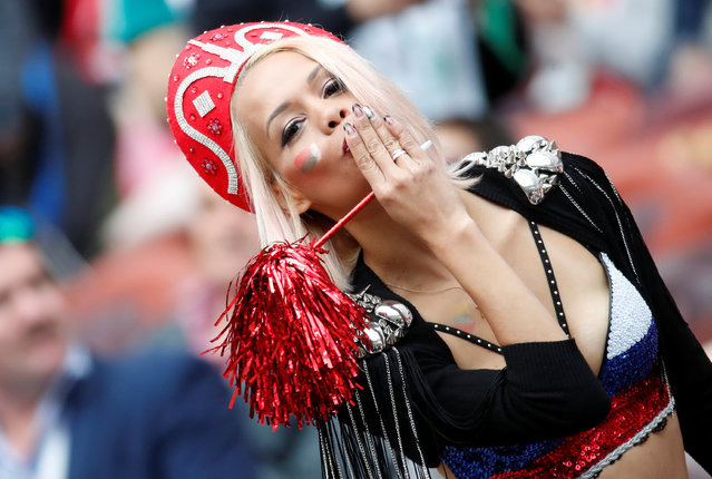 A Russia fan poses before the Russia 2018 World Cup Group A football match between Russia and Saudi Arabia at the Luzhniki Stadium in Moscow on June 14, 2018. (Photo by Christian Hartmann/Reuters)
