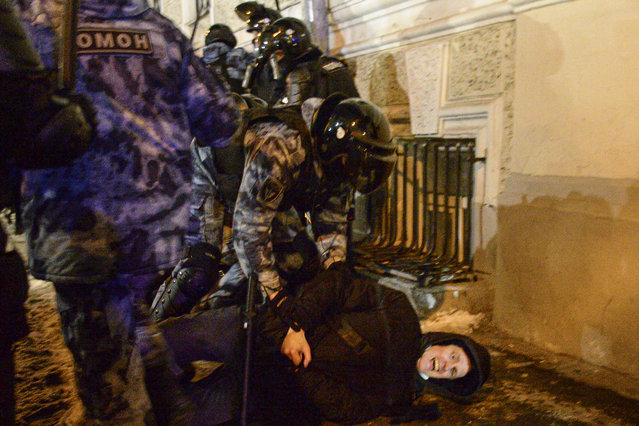 Police officers detain a Navalny supporter at the Red Square in Moscow, Russia, Tuesday, February 2, 2021. A Moscow court has ordered Russian opposition leader Alexei Navalny to prison for more than 2 1/2 years on charges that he violated the terms of his probation while he was recuperating in Germany from nerve-agent poisoning. Navalny, who is the most prominent critic of President Vladimir Putin, had earlier denounced the proceedings as a vain attempt by the Kremlin to scare millions of Russians into submission. (Photo by Denis Kaminev/AP Photo)